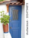 blue wooden door in a white...   Shutterstock . vector #1014754873