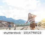 happy young girl walking on a... | Shutterstock . vector #1014798523