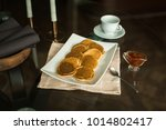pancakes on white plate with... | Shutterstock . vector #1014802417