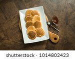 pancakes on a wooden board with ... | Shutterstock . vector #1014802423