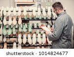 manager at a leather shoe... | Shutterstock . vector #1014824677