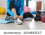 woman tying shoelace before... | Shutterstock . vector #1014843217