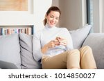 a smiling brunette mature woman ... | Shutterstock . vector #1014850027