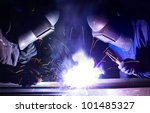 Two Workers Welds The Metal....