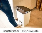 open the lid with your foot on... | Shutterstock . vector #1014863083