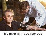 older man fell  while running...   Shutterstock . vector #1014884023