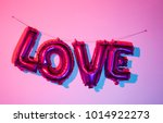 some fuchsia letter shaped... | Shutterstock . vector #1014922273