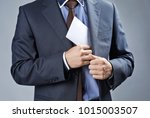 businessman putting envelope... | Shutterstock . vector #1015003507