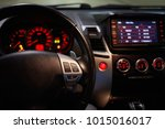 steering wheel and glowing car... | Shutterstock . vector #1015016017