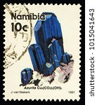 "Small photo of Moscow, Russia - February 01, 2018: A stamp printed in Namibia shows blue crystals of azurite, series ""Oranjemund Alluvial Diamond Mine"", circa 1991"