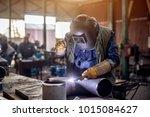profesional welder in... | Shutterstock . vector #1015084627
