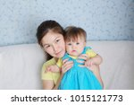 mother and child portrait ... | Shutterstock . vector #1015121773