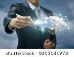 businessman draws a network... | Shutterstock . vector #1015131973