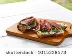 antipasti bruschetta with jamon ... | Shutterstock . vector #1015228573
