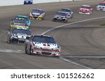 LAS VEGAS, NV - MARCH 11:  Tony Stewart (14) and Jimmie Johnson (48) battle for position during the Kobalt Tools 400 race at the Las Vegas Motor Speedway in Las Vegas, NV on March 11, 2012. - stock photo