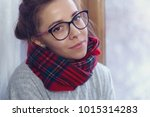 a girl in glasses and a warm... | Shutterstock . vector #1015314283