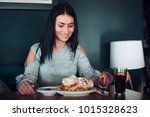 cheerful woman is about to eat.   Shutterstock . vector #1015328623