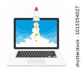 rocket launching on laptop... | Shutterstock .eps vector #1015354027
