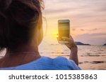 women use smartphone taking a... | Shutterstock . vector #1015385863