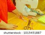 tailor hands working with... | Shutterstock . vector #1015451887