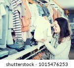 smiling american girl deciding...   Shutterstock . vector #1015476253