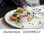 Small photo of Smashed Avocado served with poached eggs, wafter thin radishes and cherry tomatoes