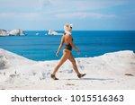 a sporty woman in a bikini is... | Shutterstock . vector #1015516363
