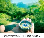 hiking with compass in mountains | Shutterstock . vector #1015543357