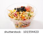 Close up of take away bowl with fast food salad - stock photo
