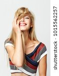 gorgeous blond girl in striped... | Shutterstock . vector #1015562257