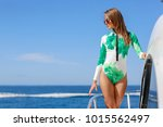 girl in swimsuit on boat  | Shutterstock . vector #1015562497
