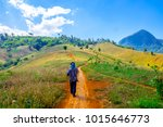 the tribe man is walking to the ... | Shutterstock . vector #1015646773