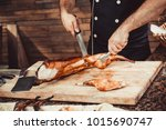 chef hands cutting grilled... | Shutterstock . vector #1015690747
