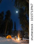 couple camping with campfire... | Shutterstock . vector #1015713967