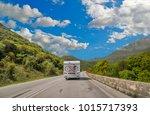 caravan car on the road in... | Shutterstock . vector #1015717393