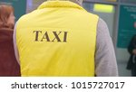 the man in the taxi jacket ... | Shutterstock . vector #1015727017