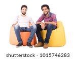 two smiley friends sitting on... | Shutterstock . vector #1015746283