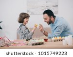father and son doing easter egg ... | Shutterstock . vector #1015749223