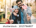 a happy guy and a girl hold a... | Shutterstock . vector #1015786807