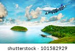 Jet liner over the tropical island. Panoramic composition in very high resolution. HDR processed. - stock photo