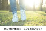 stepping in blue jeans and... | Shutterstock . vector #1015864987