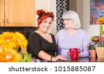 mother and daughter stand in... | Shutterstock . vector #1015885087