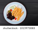 fried salmon fillet with... | Shutterstock . vector #1015973083