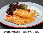fried salmon fillet with... | Shutterstock . vector #1015973107