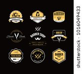 vintage barber shop badges...   Shutterstock .eps vector #1016049433