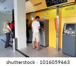 Small photo of Perak, Malaysia - February 3rd 2018 : Unidentified people using and queuing for Maybank ATM (Automatic Teller Machine) to withdraw & transfer money in one of Maybank branch at Teluk Intan, Perak.