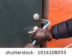 breaking into houses. | Shutterstock . vector #1016108053