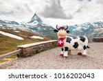 Small photo of Switzerland. Zermatt - 14 July 2013. Statue of swiss cow in the viewpoint. In the background of the Matterhorn - Pennine Alps, Switzerland.Zermatt. 14 of July 2013