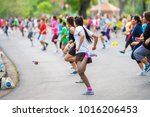Small photo of BANGKOK, THAILAND - JAN 3: People doing aerobic dance after work for exercise at Lumpini Park on January 3, 2017 in Bangkok, Thailand.