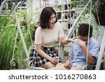 girl soothe a sad boy because... | Shutterstock . vector #1016270863